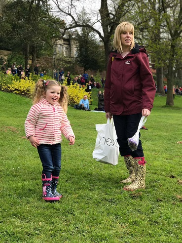 child and mum in the park whilst wearing a maternity waterproof jacket