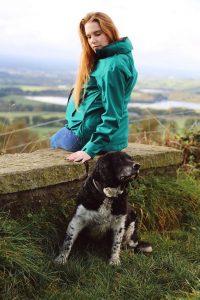 talking the dog in a maternity waterproof coat